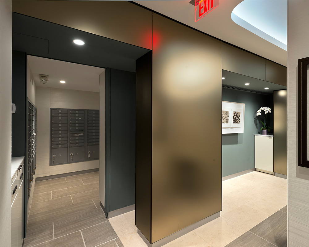 Stone flooring and wood millwork a bronze-lined vestibule and door thresholds organic shapes and naturally inspired paint colors enhance the feeling of ... & Project: Hyde Park Lobby | El Studio